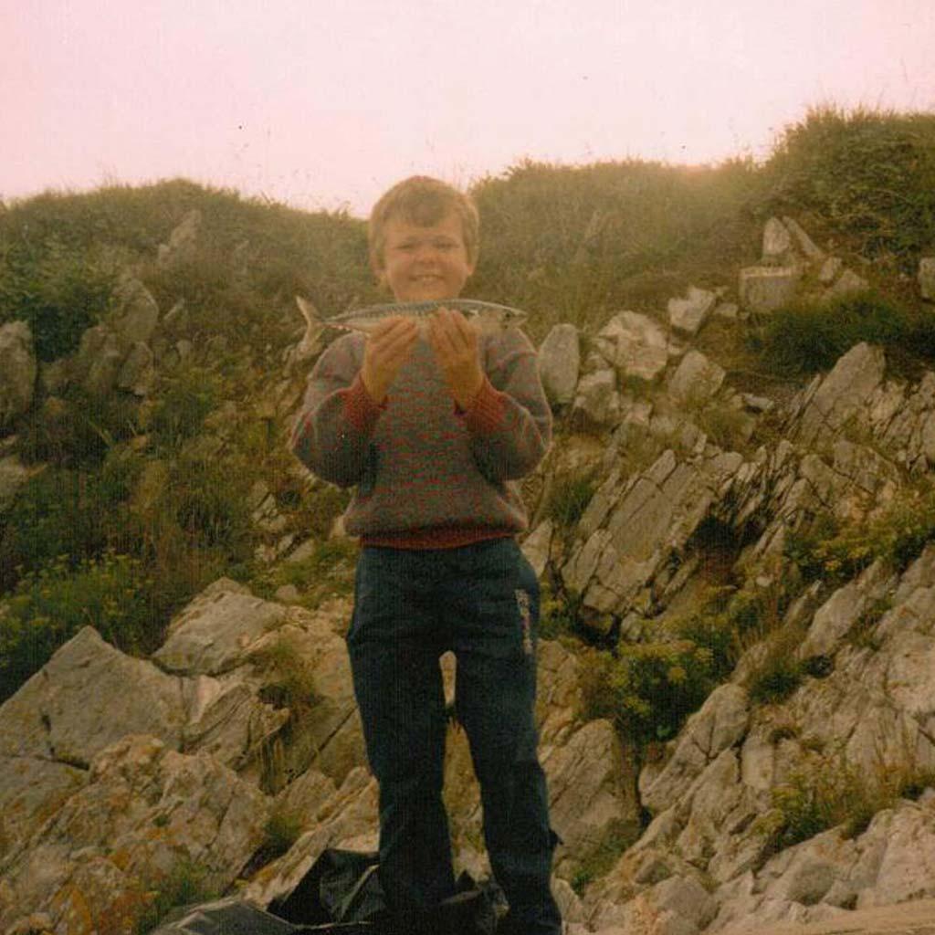 Gary with a mackerel as a kid